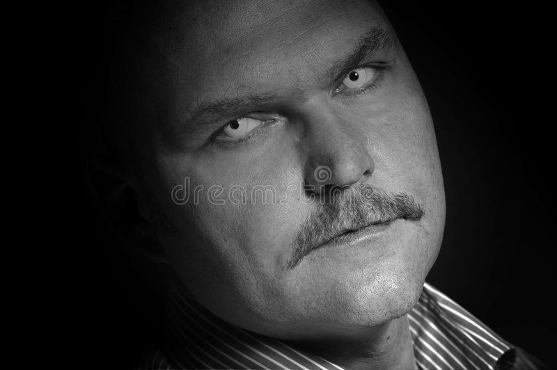 Scary man. Man with white contactlenses looking rather scary stock photo