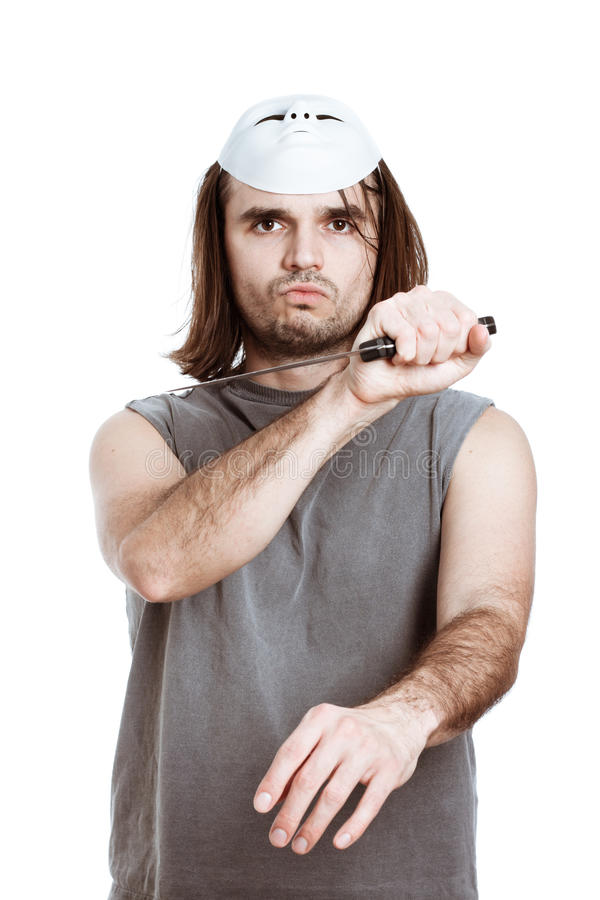 Scary man assaulting with knife royalty free stock image