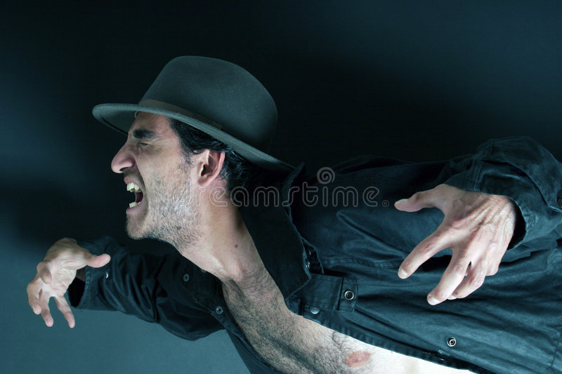 Scary man with hat royalty free stock image