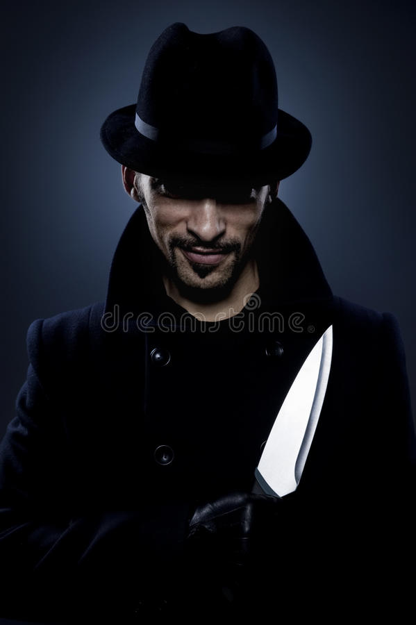 Scary man with a knife royalty free stock image