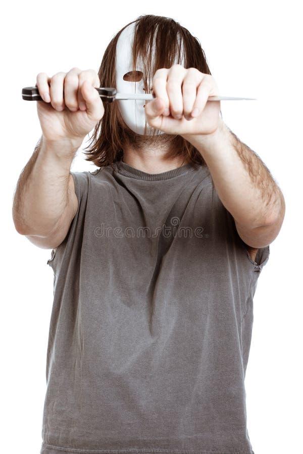 Scary masked man holding knife stock photography