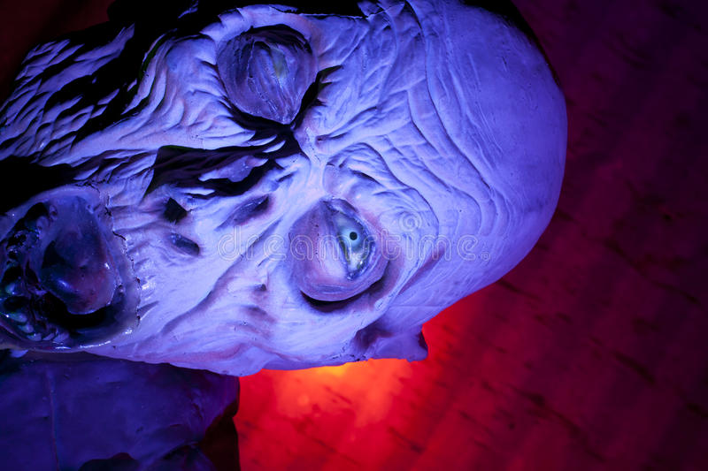 Scary Monster Ghoul. Scary ghoul in haunted house with colored light stock images