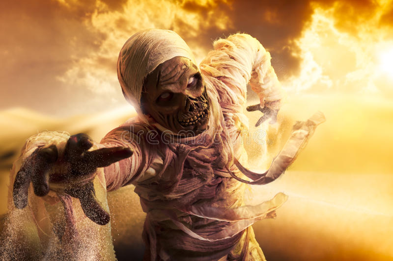Scary mummy in a desert at sunset stock photography