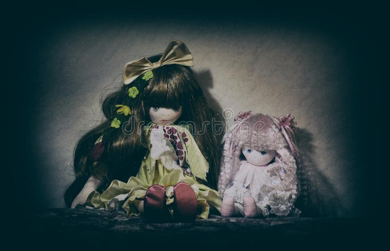 Scary old dolls. Two Scary old cracked dolls. Horror concept royalty free stock image