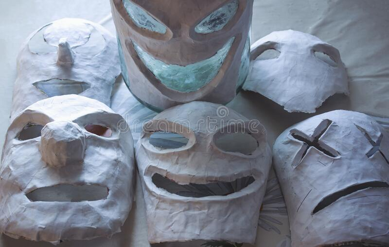 Scary papier mache masks made with your own hands. Handmade paper and dough. Masks for the holiday. Halloween royalty free stock images