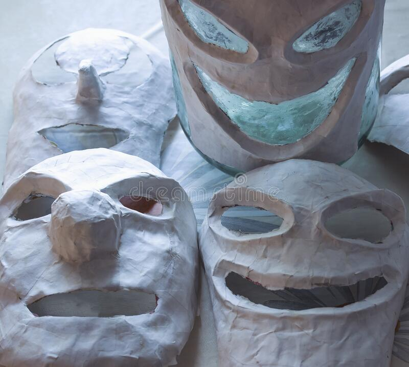 Scary papier mache masks made with your own hands. Handmade paper and dough. Masks for the holiday. Halloween stock photo