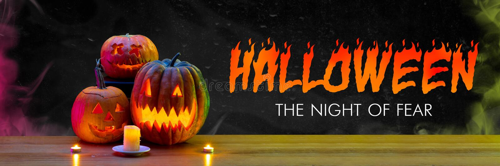 Scary pumpkins on black background, the night of fear. Fire flames and candles. Halloween, black friday, cyber monday, sales, autumn concept. Flyer for your stock photography