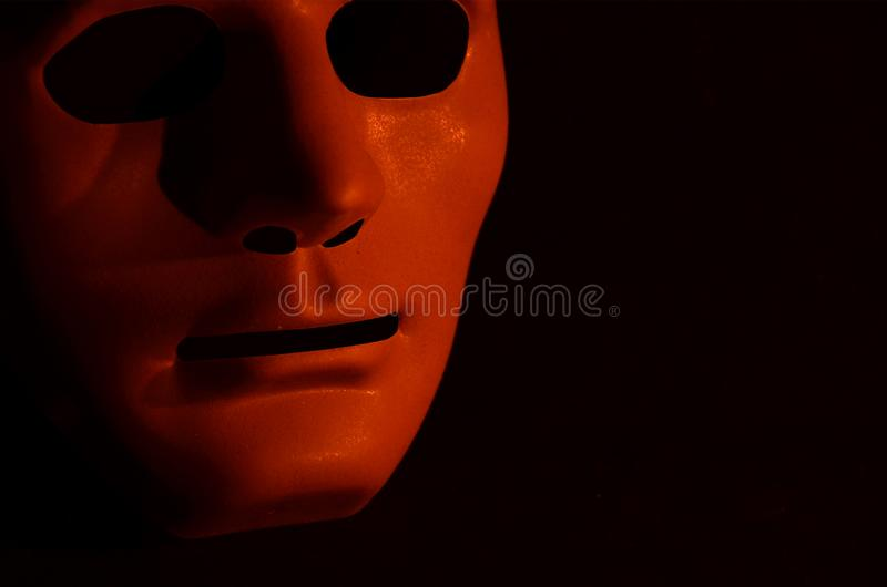 scary red mask light black background scary red hollow eyed mask light black background night 142406710