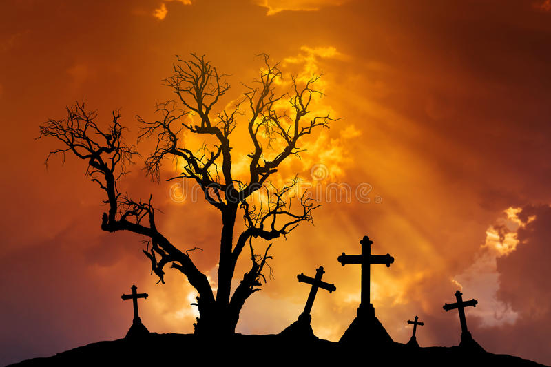 Scary silhouette dead tree and spooky crosses with Halloween concept stock photo