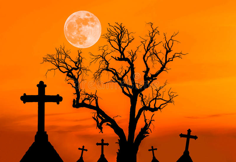 Scary silhouette dead tree and spooky silhouette crosses in mystic graveyard with half moon stock images