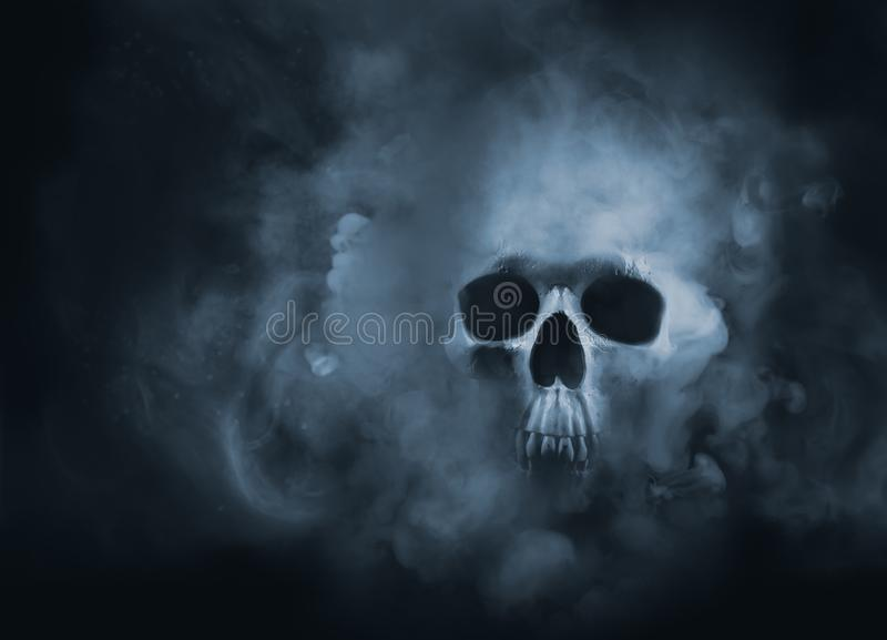 High contrast image of a skull in a smoke cloud stock photo