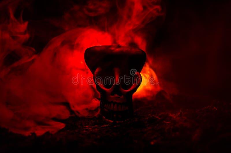 Scary skull on toned light dark background. Design for Halloween background or horror theme. Selective focus stock image