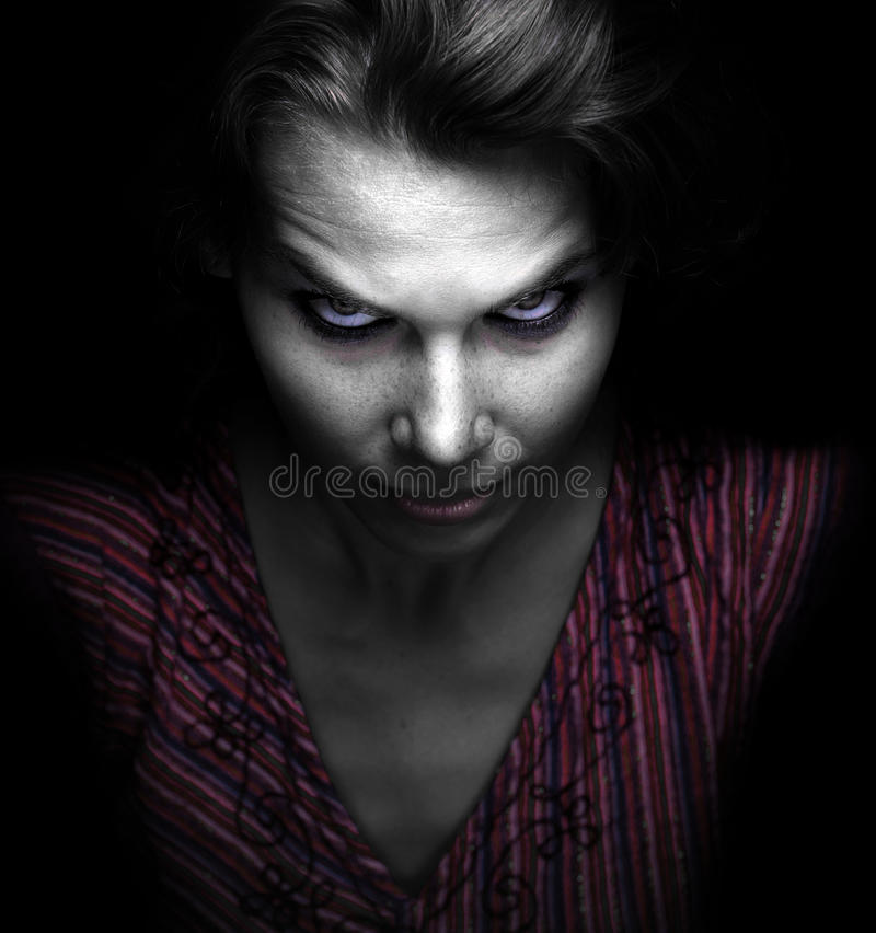 Scary spooky evil woman. In the dark royalty free stock photos