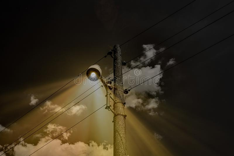 Scary street lamp on a creepy night stock images