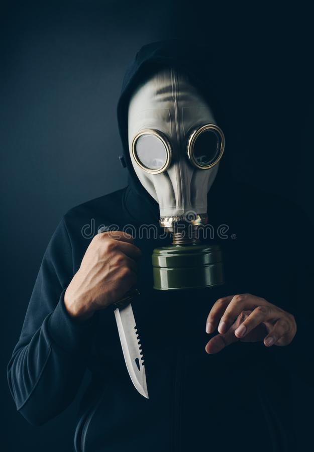 A scary thief in gas mask stock image