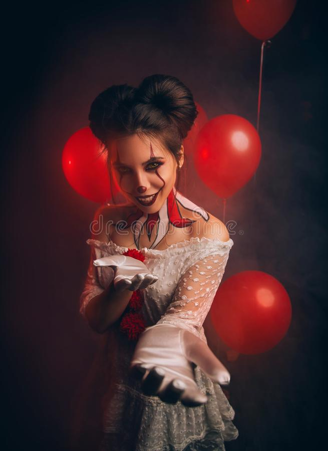 clown woman from hell invites to play. Horror movie character crazy thriller. stock images