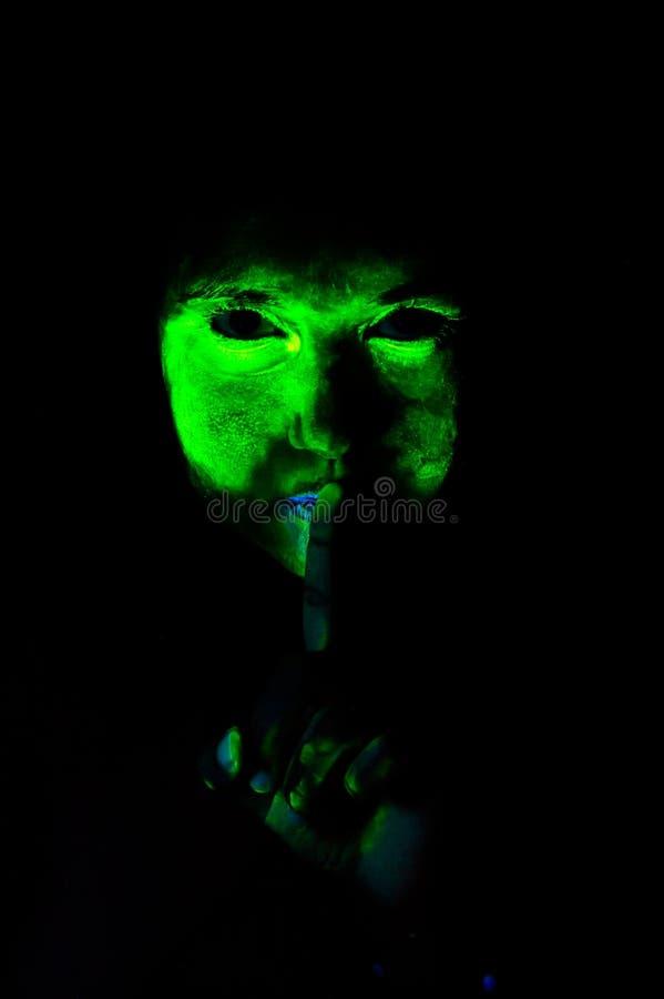 Scary uv light makeup. woman, silence. stock photos