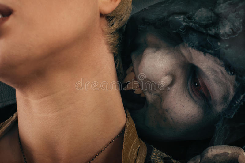 Scary vampire devil biting young woman. Medieval gothic nightmare horror. stock images