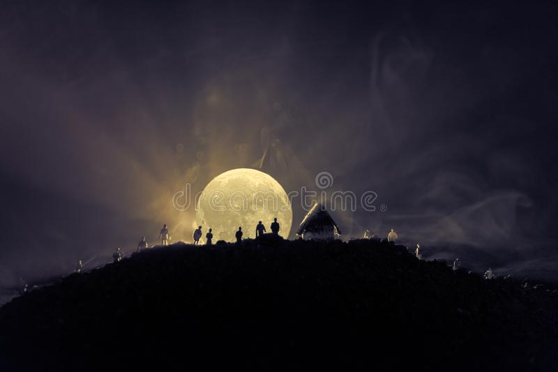 Scary view crowd of zombies on hill with spooky cloudy sky with fog and rising full moon. Silhouette group of zombie walking under. Full moon. Halloween concept stock illustration