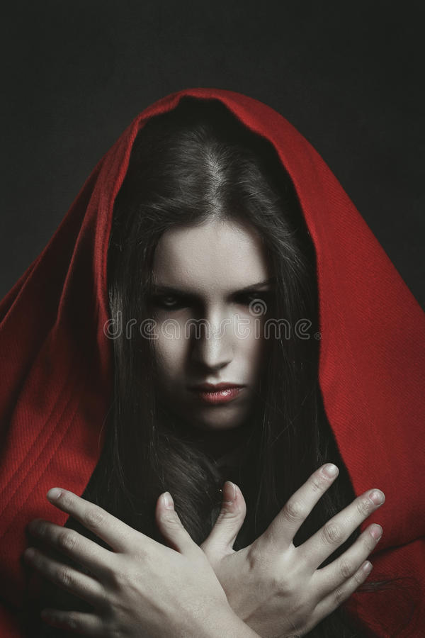 Scary witch with black eyes stock images