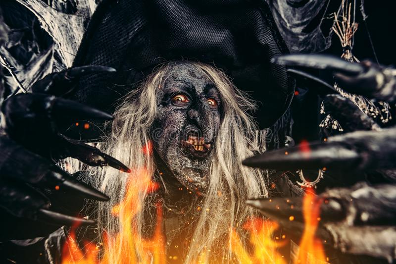 Scary witch at halloween royalty free stock photos