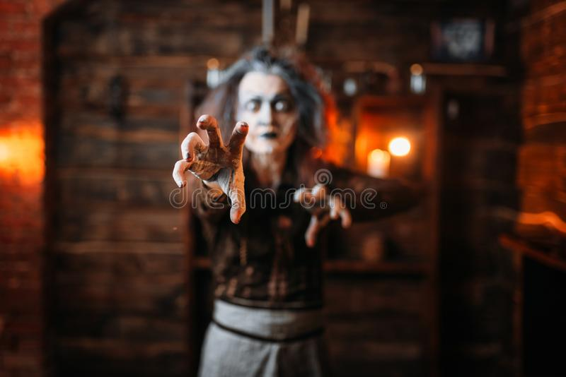 Scary witch hands out, front view. Spiritual seance. Female foreteller calls the spirits, terrible fortune teller stock photography