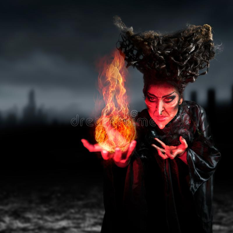 Scary witch summoning a spell royalty free stock photos