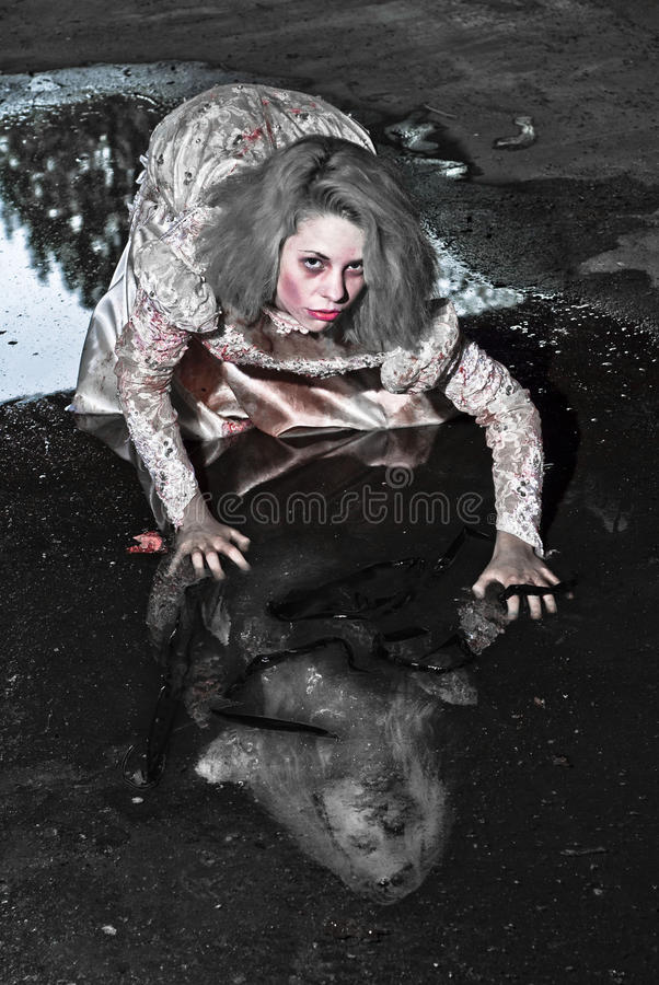 Scary woman. Gothic woman posing in natural light scared on halloween royalty free stock photo