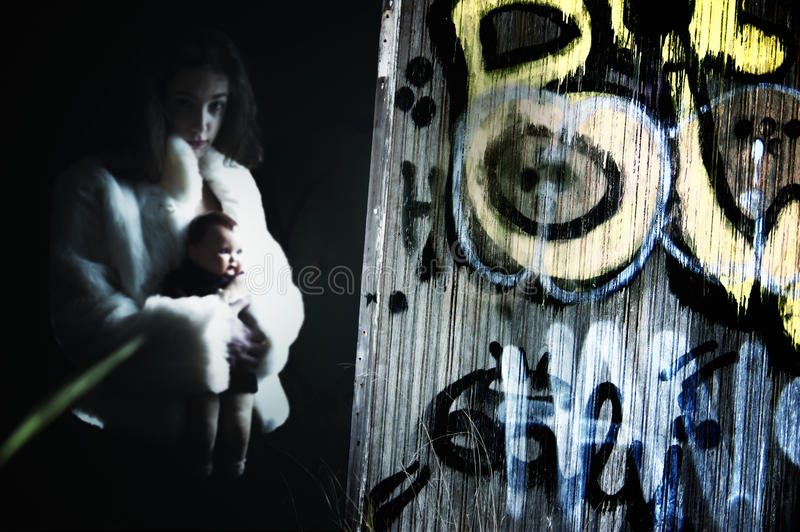 Scary young female with doll stock image