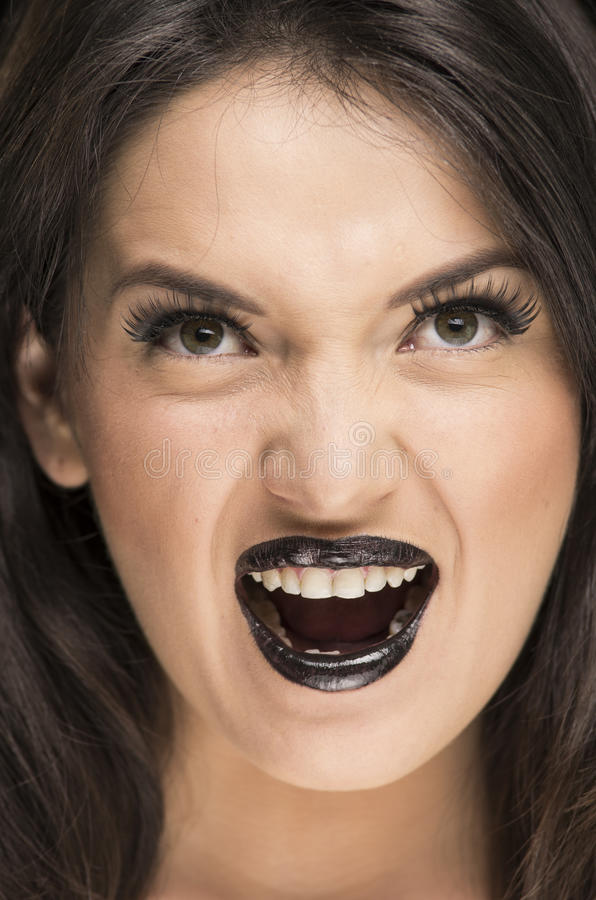 Scary young woman wearing goth makeup royalty free stock image