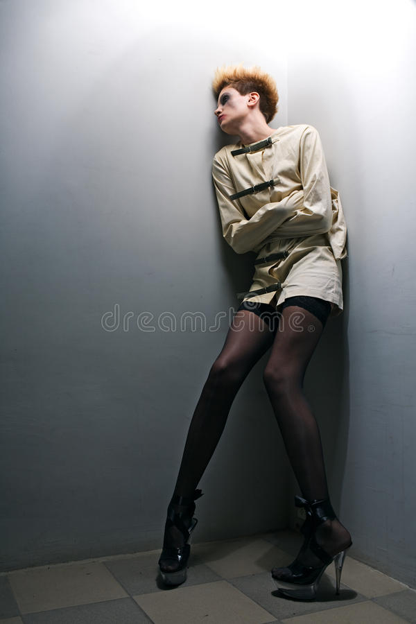 Scary zombie girl in gray room royalty free stock photo