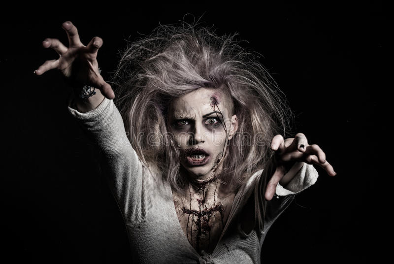 A scary zombie girl. A scary undead zombie girl stock images