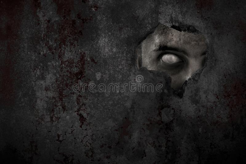 Scary zombie man eye peeking. Scary zombie man eye peek stock photos
