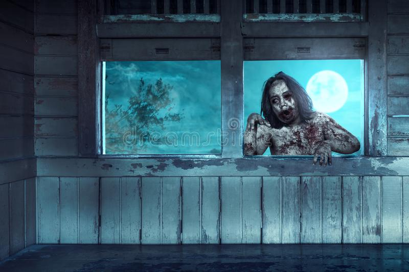 Scary zombies with blood and wound on his body haunted the old wagon. At night. Halloween concept royalty free stock image