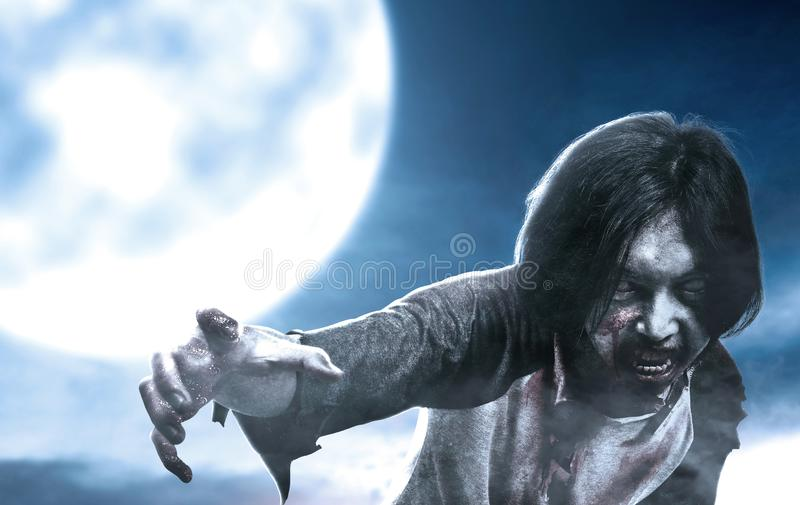 Scary zombies with blood and wound on his body walking at moonlight. Halloween concept stock photo