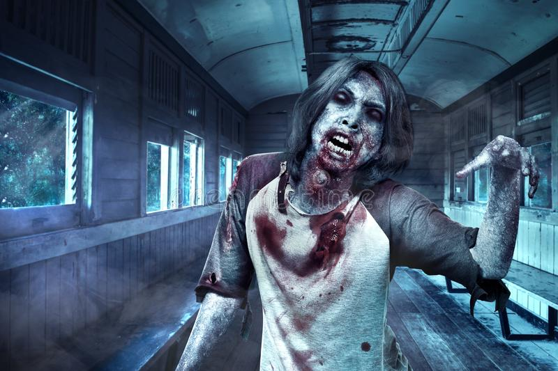 Scary zombies with blood and wound on his body walking in the old wagon. Halloween concept royalty free stock images