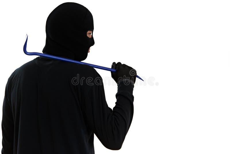 Scassinatore del ladro con il bastone a leva del metallo fotografia stock