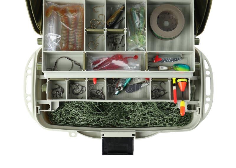 Scatola con l'attrezzatura di pesca su fondo bianco fotografia stock libera da diritti