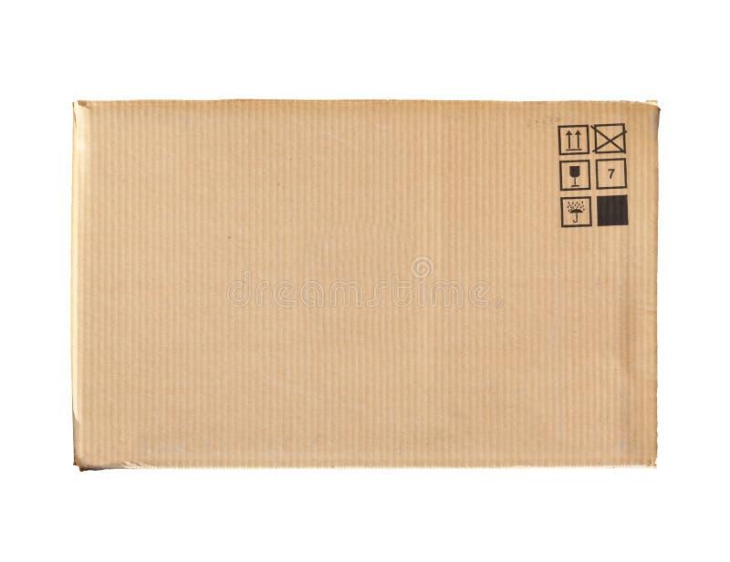 Scatola di cartone con i segni isolati su bianco fotografia stock libera da diritti