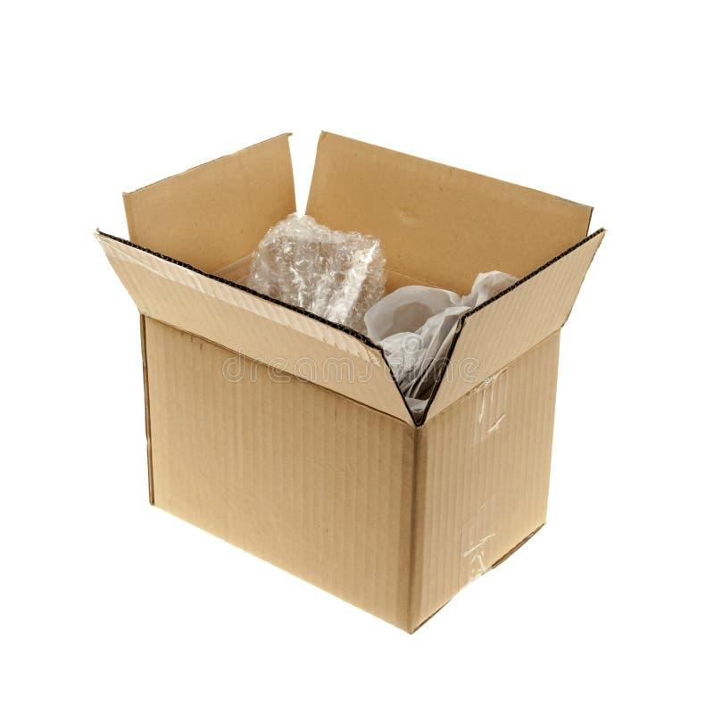 Scatola di cartone con l'imballaggio immagine stock libera da diritti