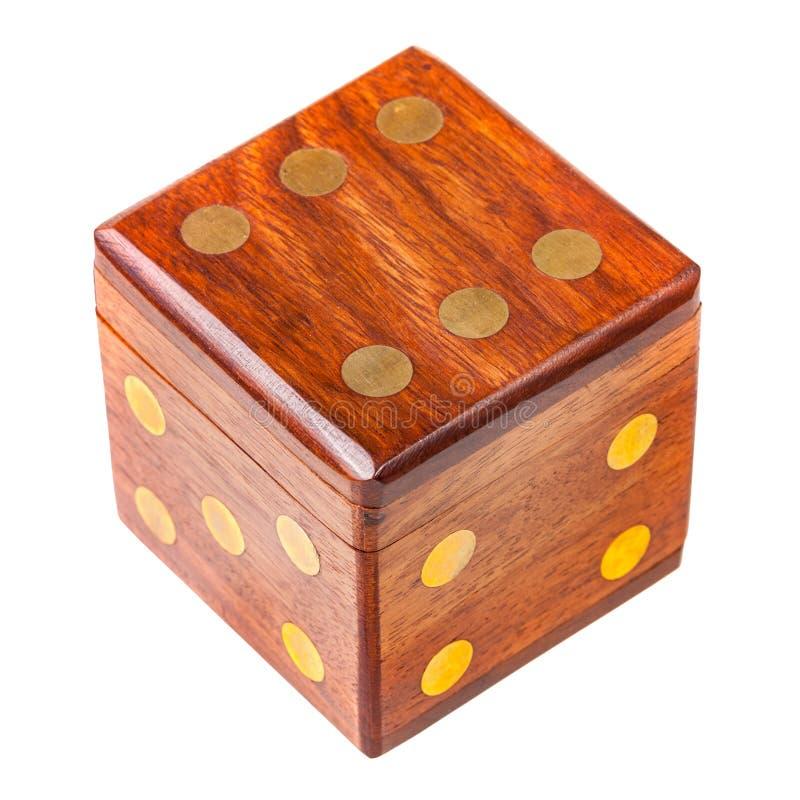 Scatola di legno sotto forma di un dado fotografia stock