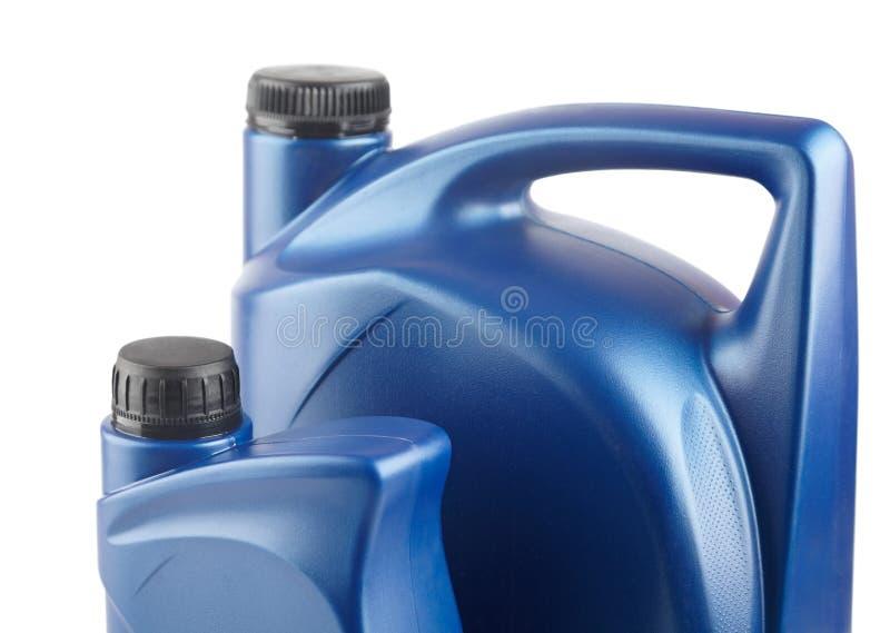 Scatola metallica di plastica blu due per i lubrificanti senza etichetta fotografia stock libera da diritti