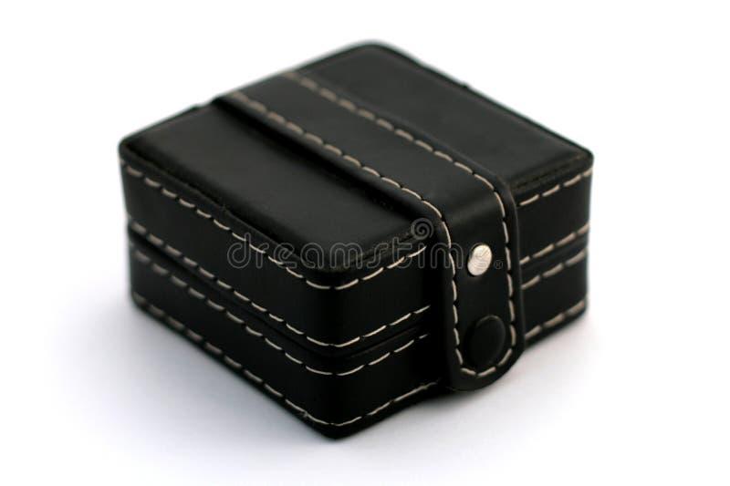 Scatola nera con l'orologio all'interno fotografie stock