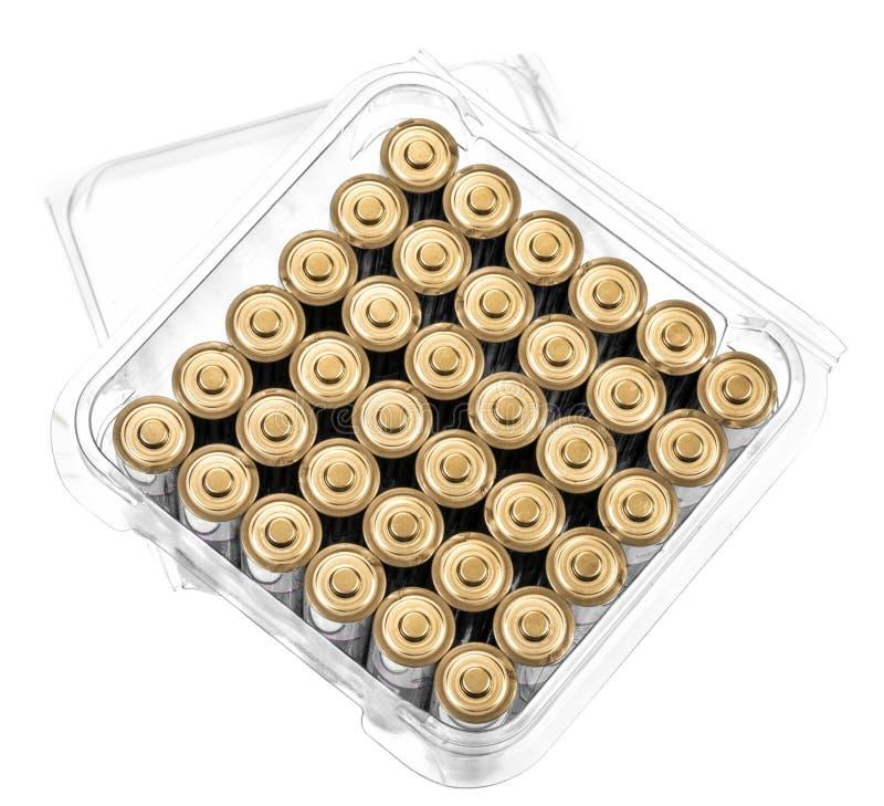 Scatola piena delle batterie AA isolata su bianco con lo spazio della copia fotografia stock libera da diritti