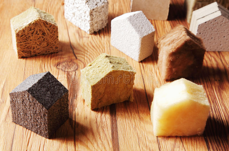 Scattered Blocks of insulation Model Hous on the Table stock photography
