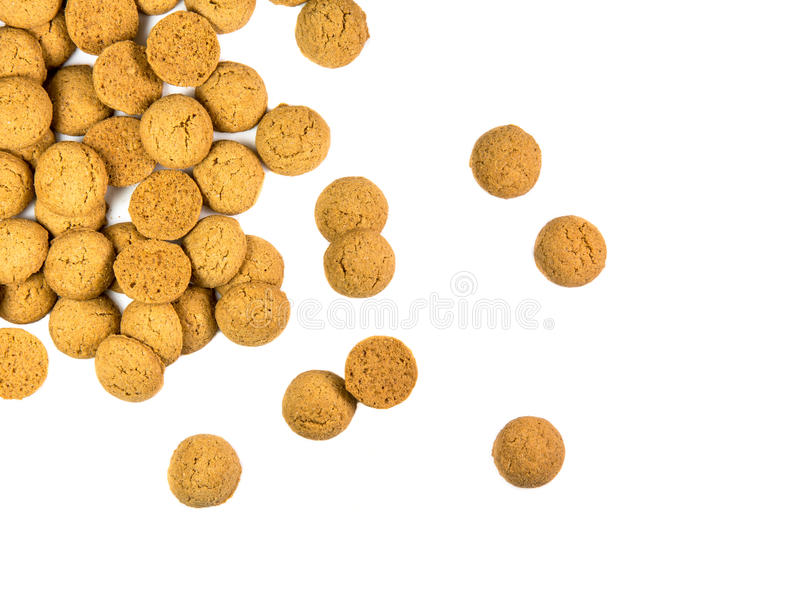 Scattered bunch of Pepernoten cookies. As Sinterklaas decoration on white background for dutch sinterklaasfeest holiday event on december 5th royalty free stock photo