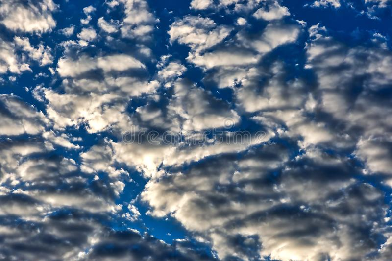 Scattered cloud pattern at sunrise over the desert southwest. Scattered clouds at sunrise over the desert southwest stock photo
