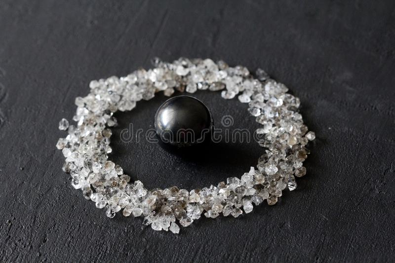 Scattered diamonds on a black background. Raw diamonds and mining, a scattering of natural diamond stones. Graphite quartz. Natural stones and minerals. Stone royalty free stock photo