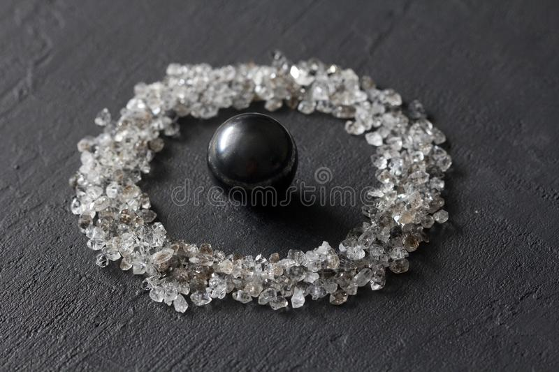 Scattered diamonds on a black background. Raw diamonds and mining, a scattering of natural diamond stones. Graphite quartz. Natural stones and minerals. Stone royalty free stock photos