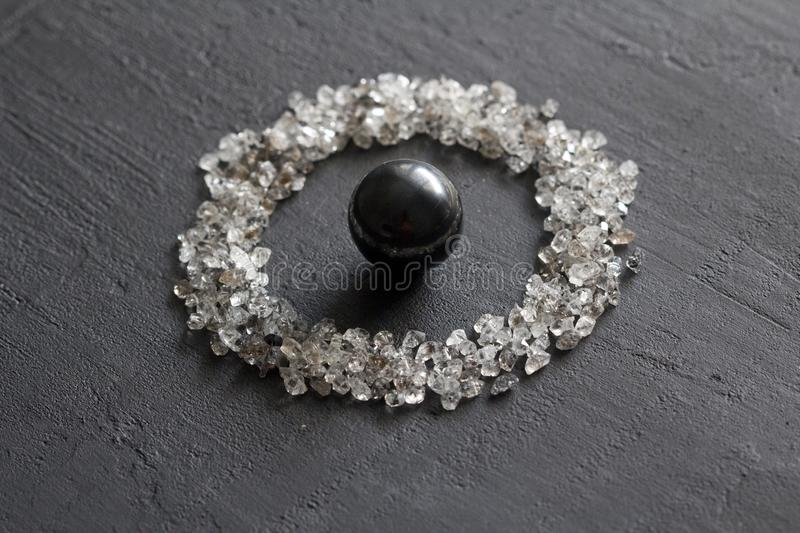 Scattered diamonds on a black background. Raw diamonds and mining, a scattering of natural diamond stones. Graphite quartz. Natural stones and minerals. Stone royalty free stock images